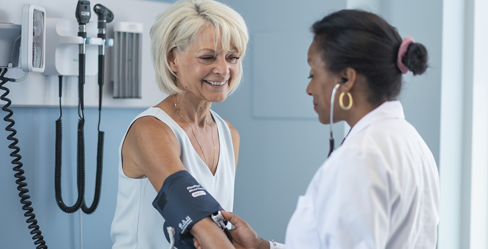 Nurse takes patient's blood pressure