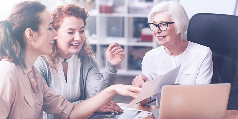Women colleagues of multiple generations working together