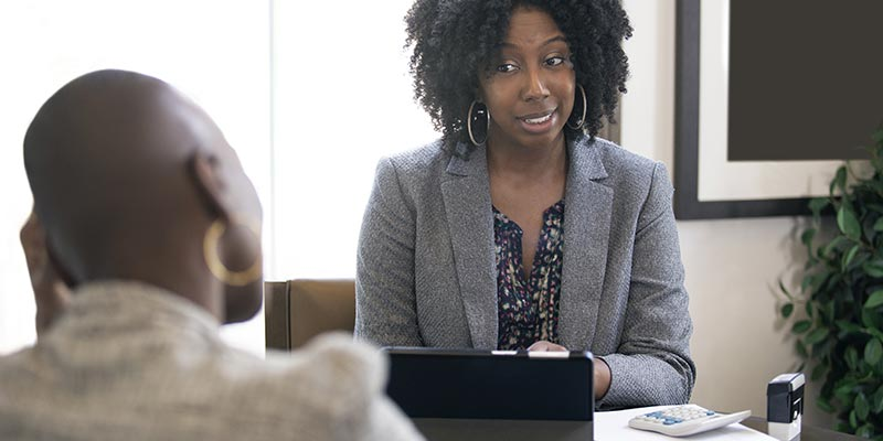 A woman and her employee having a conversation regarding the employee's performance.