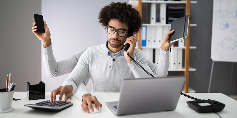 Multi-tasking businessman in the office
