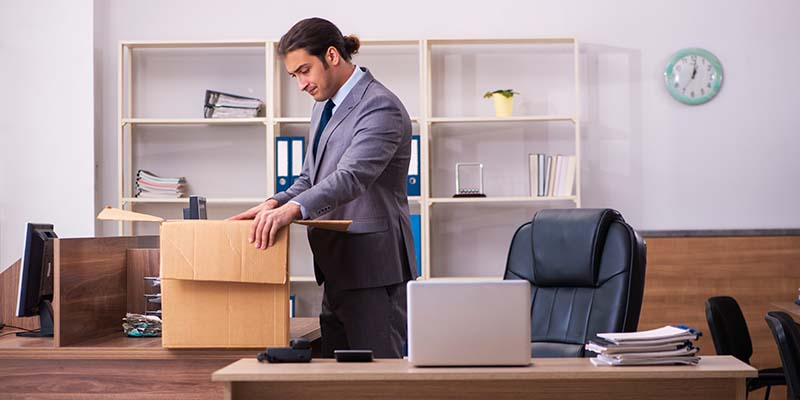 Man packs up his desk after turning in his resignation letter.