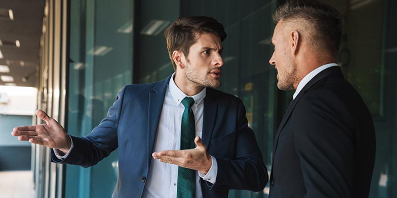 Two men are involved in a verbal conflict while at work.